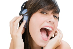 Girl wearing headphones and singing